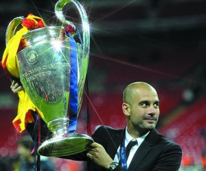 Pep Guardiola lifting the Champions League as Barcelona coach