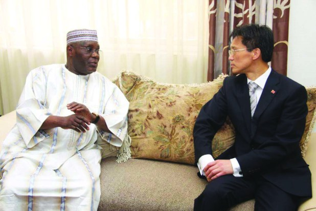 Former Vice President and chieftain of All Progressives Congress, Atiku Abubakar and Mr. Gu Xiaojie, Chinese Ambassador to Nigeria during a courtesy visit by the envoy to Atiku in Abuja on Tuesday, 21 April 2015.