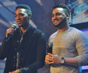 Nigerian Idol Presenter, Illrhymz (r) with P.Scholes on Stage