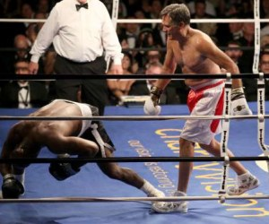 Romney (r) delivers a punch to knock down holyfield in the black-tie event which raised money for the Utah-based organization CharityVision, that helps doctors in developing countries perform surgeries to restore vision in people with curable blindness.