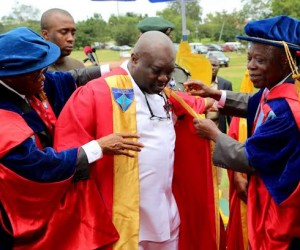 Gov. Okezie Ikpeazu being invested as Abia State University Visitor by the AG Pro-Chancellor and Chairman of the Governing Council of ABSU, Chief Chukwu Wachukwu (left) and  VC ABSU, Prof. Chibuzor Ogbuagu (right) at the University Pavilion