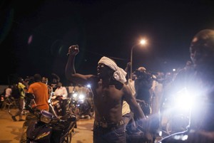Burkinabes demonstrating near the presidential palace, Wednesday after soldiers arrested Burkina Faso's Transitional President and Prime Minister in Ouagadougou.