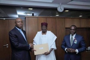 Senate President, Dr. Bukola Saraki (left), receiving President Muhammadu Buhari's list of ministerial nominations from the President's Chief of Staff, Abba Kyari, at the National Assembly, Abuja…on Wednesday. With them is Senior Special Adviser to the President on National Assembly (Senate), Senator Ita Enang.