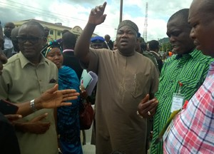 Chairman of the Electoral Panel for the PDP Guber primaries in Kogi State, Gov. Ifeanyi Ugwuanyi of Enugu state (center) with the panel's secretary, Sen. John Owan Enoh (left), during the primaries at Conference Stadium Lokoja, Monday