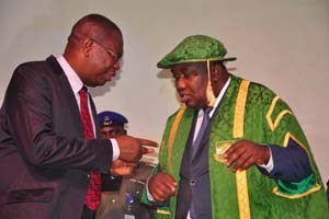 The UNN VC (left) in an interactive session with the governor of Enugu State, Ifeanyi Ugwuanyi during Founders' Day anniversary at UNN