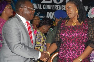 The wife of the Enugu State Governor Her Excellency, Monica Ugwuanyi (right) in a warm handshake with the provost, Enugu State College of Education Technical, Sir Anthony Chinwuba Anih, on the occasion of 20th National Conference/workshop 2015 of Women in Colleges of Education at Enugu