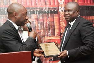 Lagos State Governor, Mr. Akinwunmi Ambode (right), receiving an award of Excellence from Hon. Justice Akeem Olatunde Oshodi, during the 2015/2016 Legal Year Dinner, at the Law School, Victoria Island, Lagos, on Friday, October 2, 2015.