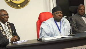 : Lagos State Governor, Mr. Akinwunmi Ambode (middle), flanked by the Chairman, Association of Professional Bodies of Nigeria, Lagos State Chapter, Mr. Bolarinde Patunola-Ajayi (left) and Commissioner for Commerce, Industry & Cooperatives, Prince Rotimi Ogunleye (right), during a courtesy visit to the Governor by the Association, at the Lagos House, Ikeja, on Tuesday, October 20, 2015.