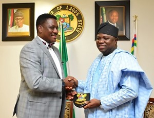 Lagos State Governor, Mr. Akinwunmi Ambode (right) presenting a state plaque to the President of Lagos Lawn Tennis Club, Barrister Rotimi Edu, during a courtesy visit to the Governor by the President and Board of Trustees of Lagos Lawn Tennis Club, at the Lagos House, Ikeja, on Wednesday, September 30, 2015.