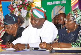Lagos State Governor, Mr. Akinwunmi Ambode (middle) with his Deputy, Dr. (Mrs.) Oluranti Adebule (right) and the State Chairman, All Progressives Congress (APC), Otunba Henry Ajomale, during the maiden edition of the Quarterly Town Hall meeting to render account of stewardship of Governor Ambode's administration 1st quarter in Office, at the Abesan Mini Stadium, Abesan Housing Estate, Ipaja, Lagos, on Tuesday, October 06, 2015.