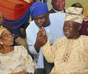 Lagos State Governor, Mr. Akinwunmi Ambode (middle) with the State first Civilian Governor, Alhaji Lateef Jakande (right) and his wife, Alhaja Abimbola, during the Swearing-in ceremony of Commissioner and Special Advisers, at the Adeyemi Bero Auditorium, the Secretariat, Alausa, Ikeja, on Monday, October19, 2015.