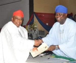 Lagos State Governor, Mr. Akinwunmi Ambode (right) congratulating Dr. Samuel Adejare, after being sworn in as Commissioner for the Environment, at the Adeyemi Bero Auditorium, the Secretariat, Alausa, Ikeja, on Monday, October19, 2015.