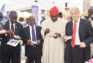 (L-r): Vice President and Chairman Membership Committee (LCCI) Mr Babatunde Ruwase, Executive Director Stakeholders and Corporate Communication Dangote Group Engr Mansur Ahmed, President (LCCI) Mr Remi Bello, and Executive Director ,Sale and Marketing Service, Dangote Cement Plc, Mr Kunt Ulvmoen, ,  at the Dangote Special Day at the ongoing Trade Fair held at TBS in Lagos on  Wednesday 11/11/2015.