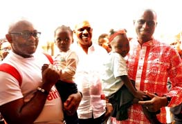 (L-R): Director, Corporate Communications & CSR, Airtel Nigeria, Emeka Oparah; Director, Arrow of God Orphanage, David Ogo-Tsegah; Managing Director and Chief Executive Officer,  Airtel Nigeria, Segun Ogunsanya with kids of the orphanage during the visit of Airtel employees and donation to the home at Ajah, Lagos, Tuesday.
