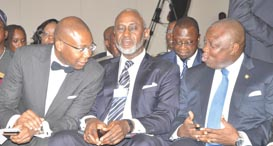 Lagos State Governor, Mr. Akinwunmi Ambode (right), discussing with President, Nigeria Stock Exchange (NSE), Mr. Aigboje Aig-Imoukhuede (left) while former Chairman, Board of Access Bank Plc., Mr. Gbenga Oyebode (middle), looks on, during the Access Leadership Conference 2015 with the theme - Leading a Transformational World: The Imperative of Innovation, at the Eko Hotels &Suites, Victoria Island, Lagos, on Thursday