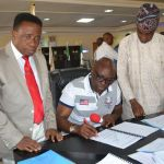 (Photonews)  Gov. Fayose signs 2016 Ekiti Appropriation Bill into Law
