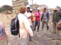 Dandora Waste pickers' Secretary Julius Gitua shares a point with Elaine. Photo credit: Evalyne Wanyama.