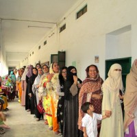 Women in Pakistan wait to vote