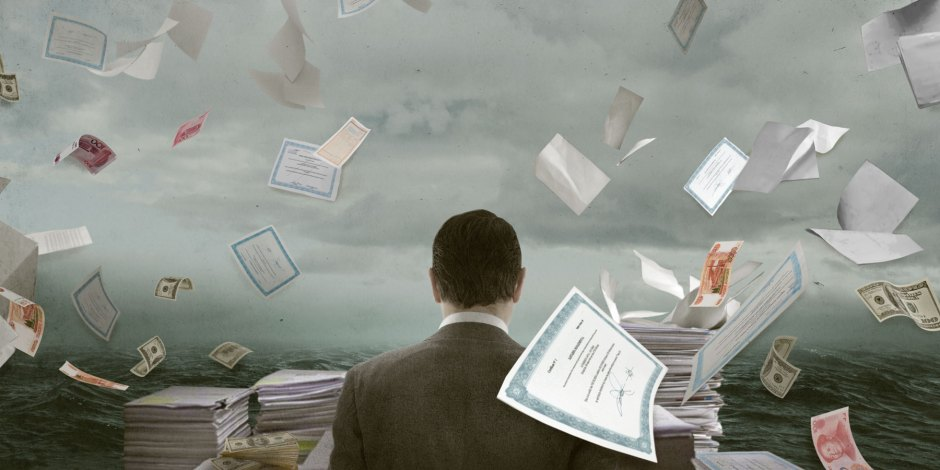 Illustration of papers swirling all around a businessman
