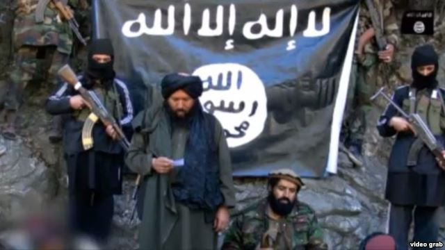 IMU leader Usmon Ghazi (second left) pledges loyalty to ISIS