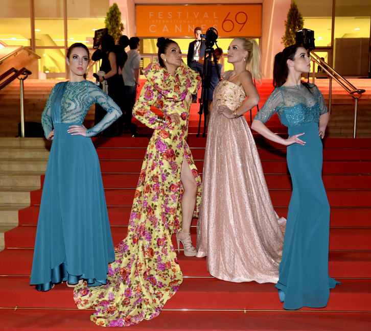 Models wearing gowns by designer Andres Aquino strike a pose on the legendary Cannes Film Festival Red Carpet after the Global Short Film Awards Gala in May 2016.