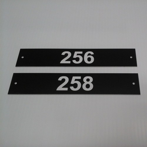 "Lasered room # signs, 1.5"" x 8"", $7.00 each + setup"