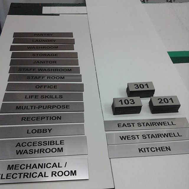 Lasered door signs