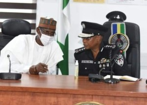 The IGP of police, Usman Baba Alkali, right with the minister of the FCT, Muhammad Musa Bello, at the force headquarters in Abuja on Wednesday