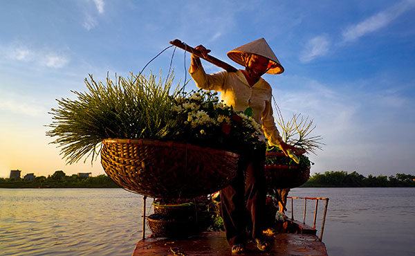 BALANCING ACT With a population of 90 million and quick access to China, Vietnam is attractive for business.  Head north, and complexities mount as government favoritism proliferates.