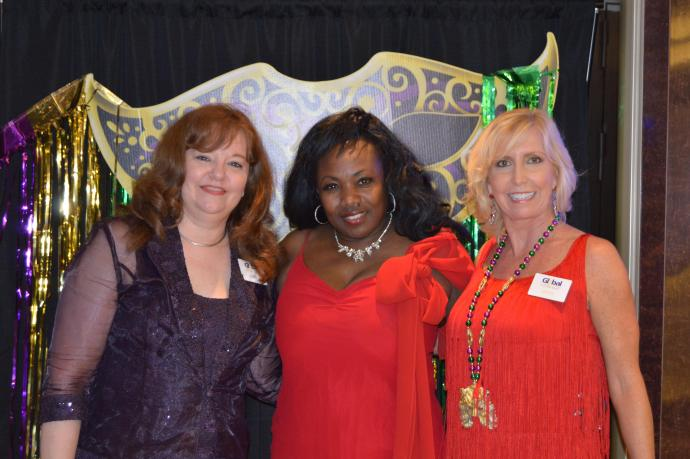 From left: Global Travel Manager Lori Smith, jazz entertainer Cleo Heart and Global Travel Consultant Jacky Butler