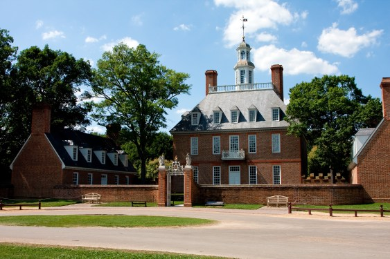 The Governor's Palace in Colonial Williamsburg, Virginia. A brick Colonial house with a courtyard, and former home of Thomas Jefferson.