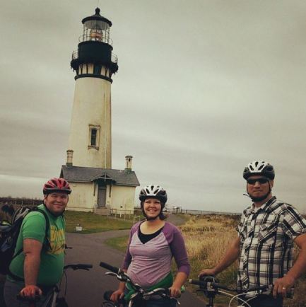 Member Dustin V. and friends biking by the Yaquina lighthouse.