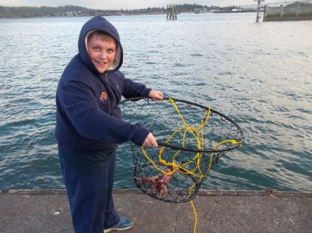 Member Lasha S.'s condo in Newport, Oregon, had a crabbing dock and cooking station where they learned how to catch, cook and clean them.