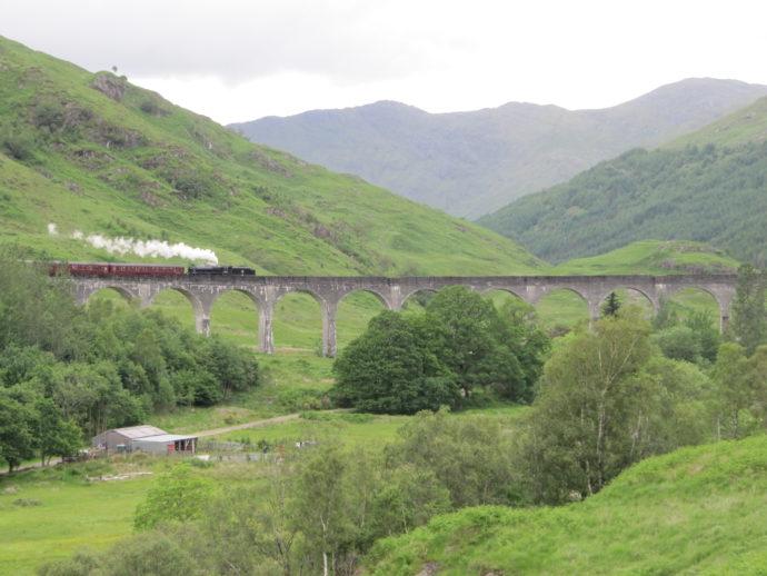 The Jacobite crossing the Glenfinnan Viaduct. Photo Credit: Loretahur/Flickr