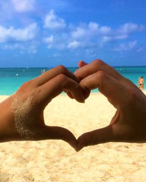 """My wife and I showing our love and gratitude for each other, traveling and GDV on the gorgeous Cayman Islands during our Thanksgiving break."" - Adam P."