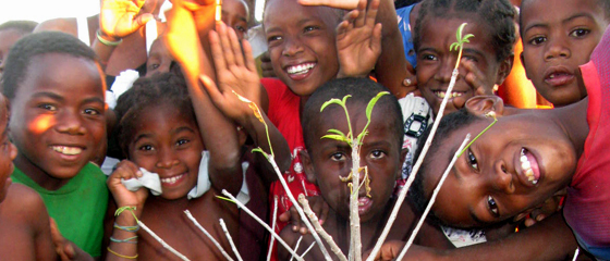 Header - kids - with baobab seedling. Credit Georgina Magin