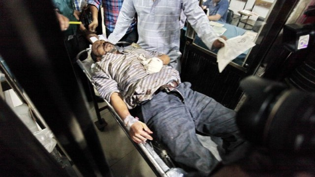 An injured blogger is being taken to the hospital. Extremists attacked three bloggers in the office of Shuddhoshor Publications in Dhaka, Bangladesh. Image by Khandaker Azizur Rahman. Copyright Demotix (31/10/2015)