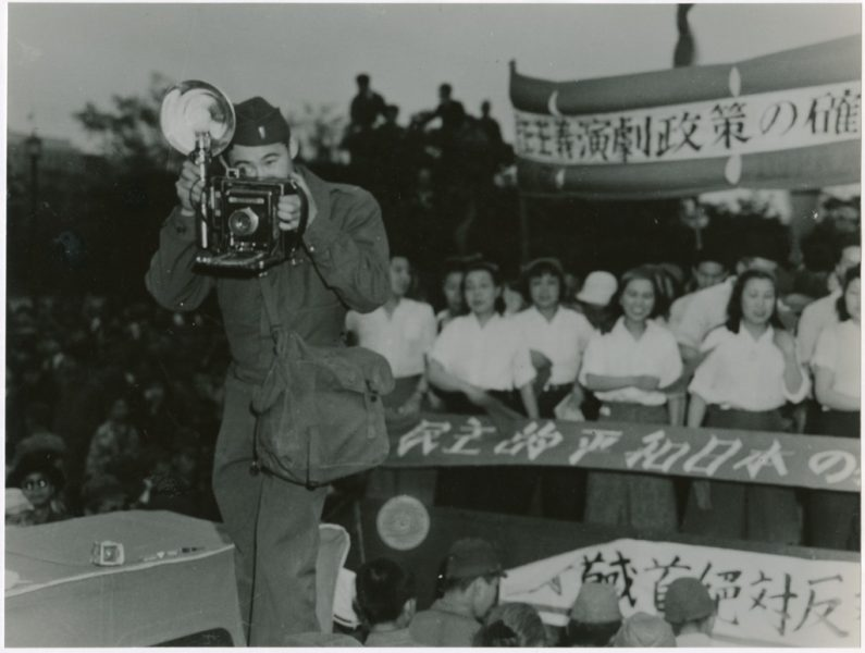 Ted Akimoto taking a photograph
