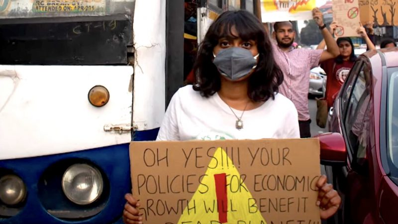 Disha Ravi in a protest. Screenshot from YouTube Video by Mojo Story. Fair use.