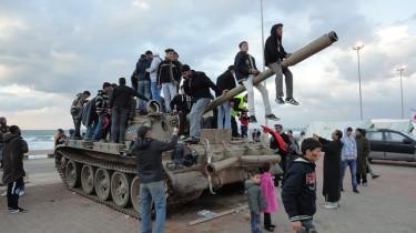 Libya: Kids playing on a tank