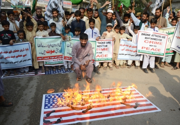 Activities of Jammat Ul Dawa hold a protest against the Drone attacks in Pakistan and killing of innocent peoples by the drone attacks. They also burned the US flags during the protest out side the Hyderabad press club. Image by janali laghari. Copyright Demotix (8/11/2013)
