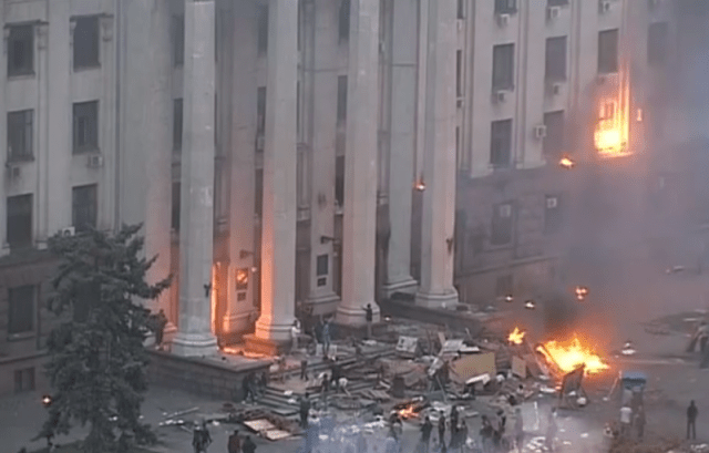 The besieged Odessa Union building. A Molotov cocktail explodes in the top right corner of the frame. Dozens died in the ensuing fire. YouTube screenshot.