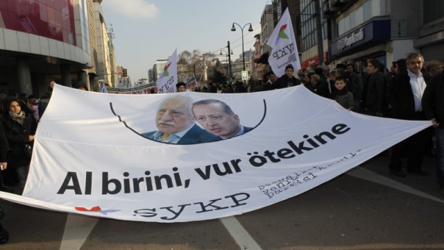 "Thousands protest in Istanbul against corruption and Erdogan's Govt in Dec. 2013. A banner with Fethullah Gulen and PM Erdogan's pictures reads ""one is no better than the other"". Fulya Atalay for Demotix."