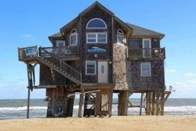 What happens to coastal real estate values in the face of sea level rise?
