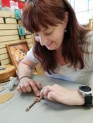image of me making a ukelele keyring at KoAloha Ukelele, prior to my tour of the factory