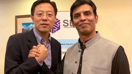 Chinese diplomat Lijian Zhao embraces Pakistani economic development expert Abid Qaiyum Suleri. (Image Credit: @Abidsuleri via Twitter)