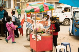 Churros and picarones, similar to donuts, are popular snack items in Peru, and you can find vendors on every street corner selling these delicious pastries.