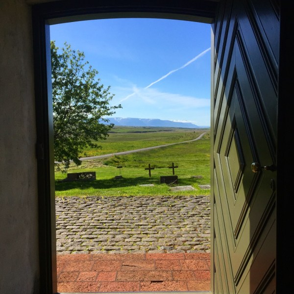 Looking out the front door of Holar Cathedral, Holar, Iceland