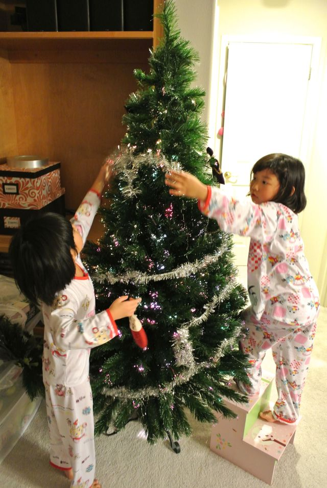 Decorating their Christmas tree together