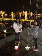 Setting off their wish lanterns in Hoi An